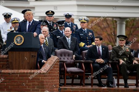 Donald Trump, Mark Esper, Joseph Dunford, Mike Pence. President Donald Trump, left, speaks during a ceremony welcoming Chairman of the Joint Chiefs of Staff Gen. Mark Milley at Joint Base Myer-Henderson Hall, Va., . Seated frontrow from left are Vice President Mike Pence, Defense Secretary Mark Esper and outgoing chairman of the Joint Chiefs of Staff Gen. Joseph Dunford