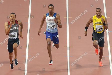 Andre de Grasse (Canada), Zharnel Hughes (Great Britain), Yohan Blake (Jamaica), 200 Metres Men's Semi-Final, Heat 3, during the 2019 IAAF World Athletics Championships at Khalifa International Stadium, Doha