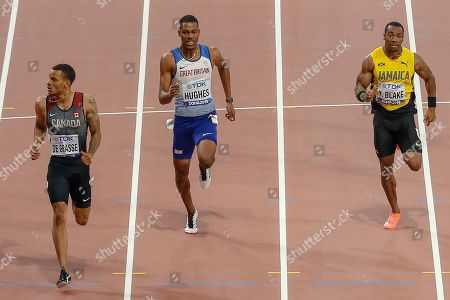 Stock Image of Andre de Grasse (Canada), Zharnel Hughes (Great Britain), Yohan Blake (Jamaica), 200 Metres Men's Semi-Final, Heat 3, during the 2019 IAAF World Athletics Championships at Khalifa International Stadium, Doha