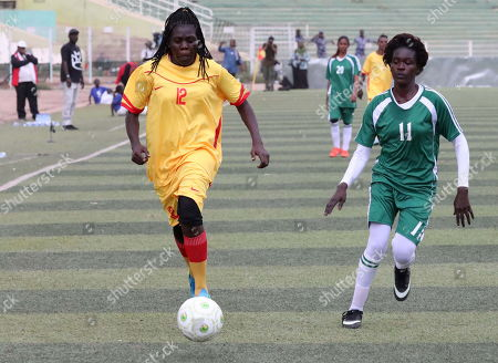 Sudanese female soccer players of Tahadi (R) and Difaain (L) fight for the ball during the first ever Sudanese women?s club football league soccer match, in Khartoum, Sudan, 30 September 2019. The competition will see 21 teams competing. Only months after the ousting of president Omar Hassan al-Bashir, and the formation of joint military civilian council, the championship is seen as a sign of opening and change in Sudan.