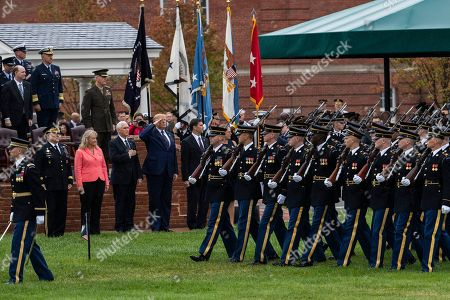 Donald Trump, Mark Milley, Mark Esper, Joseph Dunford, Mike Pence. President Donald Trump, center, with, from left, Chairman of the Joint Chiefs of Staff Gen. Mark Milley and his wife Hollyanne Milley, Vice President Mike Pence, Defense Secretary Mark Esper and former chairman Gen. Joseph Dunford, back, salutes service members from the U.S. Army as they march during a pass and review at Joint Base Myer-Henderson Hall, Va