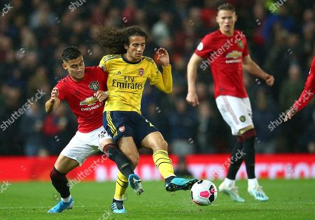 Manchester United's Andreas Pereira, left, vies for the ball with Arsenal's Matteo Guendouzi during the English Premier League soccer match between Manchester United and Arsenal at Old Trafford in Manchester, England