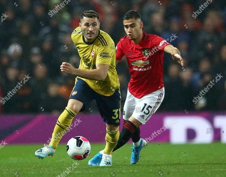 Arsenal's Sead Kolasinac, left, vies for the ball with Manchester United's Andreas Pereira during the English Premier League soccer match between Manchester United and Arsenal at Old Trafford in Manchester, England