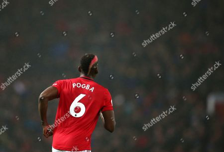 Manchester United's Paul Pogba during the English Premier League soccer match between Manchester United and Arsenal at Old Trafford in Manchester, England