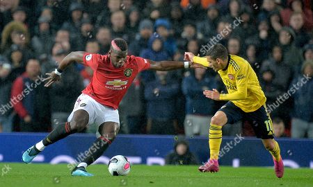 Manchester United's Paul Pogba (L) in action against Lucas Torreira of Arsenal London during the English Premier League soccer match between Manchester United and Arsenal London in Manchester, Britain, 30 September 2019.