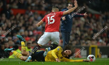 Andreas Pereira (up) of Manchester United in action against Matteo Guendouzi of Arsenal London during the English Premier League soccer match between Manchester United and Arsenal London in Manchester, Britain, 30 September 2019.