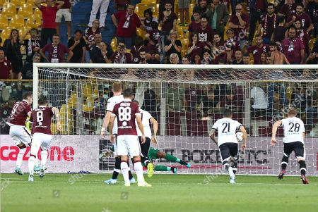 Torino's Andrea Belotti (L) converts a penalty for the 1-2 lead goal during the Italian Serie A soccer match Parma Calcio vs Torino FC at the Ennio Tardini stadium in Parma, Italy, 30 September 2019.
