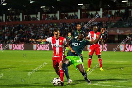 Desportivo das Aves's Welinton Junior (L) vies for the ball with Sporting CP's Yannick Bolasie during their Portuguese First League soccer match against Desportivo das Aves held at Clube Desportivo das Aves Stadium, in Vila das Aves, Portugal, 30 September 2019.