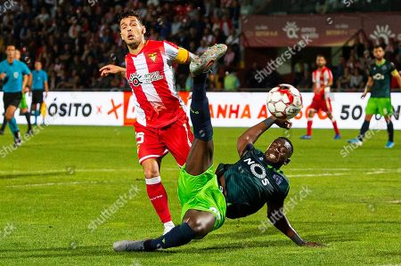 Desportivo das Aves's Afonso Figueiredo (L) vies for the ball with Sporting CP's Yannick Bolasie during their Portuguese First League soccer match against Desportivo das Aves held at Clube Desportivo das Aves Stadium, in Vila das Aves, Portugal, 30 September 2019.