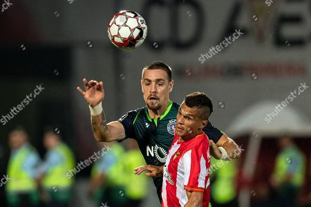 Desportivo das Aves's Ruben Oliveira (R) vies for the ball with Sporting CP's Sebastian Coates during their Portuguese First League soccer match against Desportivo das Aves held at Clube Desportivo das Aves Stadium, in Vila das Aves, Portugal, 30 September 2019.