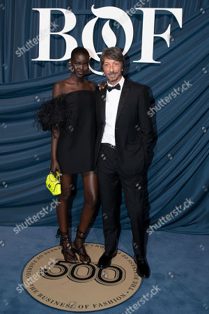 South Sudanese-Australian model Adut Akech (L) and Pierpaolo Piccioli, artistic director of Valentino (R) arrive for the Business of Fashion, BoF 500 gala held at the Hotel de Ville in Paris, France, 30 September 2019.
