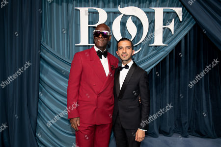 US fashion designer Dapper Dan (L) and founder and editor-in-chief of The Business of Fashion Imran Amed (R) arrive for the Business of Fashion, BoF 500 gala held at the Hotel de Ville in Paris, France, 30 September 2019.