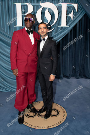 Stock Image of US fashion designer Dapper Dan (L) and founder and editor-in-chief of The Business of Fashion Imran Amed (R) arrive for the Business of Fashion, BoF 500 gala held at the Hotel de Ville in Paris, France, 30 September 2019.
