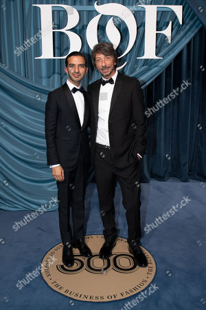 Stock Photo of Founder and editor-in-chief of The Business of Fashion Imran Amed (L) and Italian artistic director of Valentino, Pierpaolo Piccioli (R) arrive for the Business of Fashion, BoF 500 gala held at the Hotel de Ville in Paris, France, 30 September 2019.