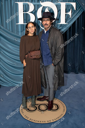 Stock Photo of Italian designer Delfina Delettrez Fendi (L) and French designer Haider Ackermann (R) arrive for the Business of Fashion, BoF 500 gala held at the Hotel de Ville in Paris, France, 30 September 2019.