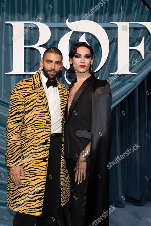 US journalist Phillip Picardi (L) and US model Miss Fame (R) arrive for the Business of Fashion, BoF 500 gala held at the Hotel de Ville in Paris, France, 30 September 2019.