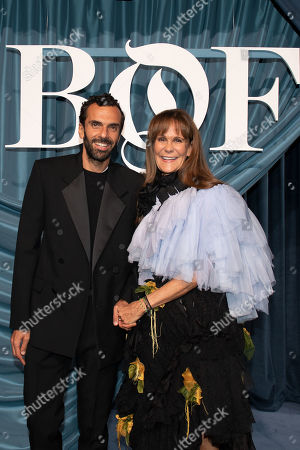 Cedric Charbit, CEO de Balenciaga (L) and Julie Gilhart, creative consultant (R) arrive for the Business of Fashion, BoF 500 gala held at the Hotel de Ville in Paris, France, 30 September 2019.