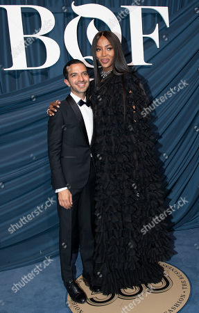 British model, singer, producer and actress, Naomi Campbell (R) and Canadian-British fashion expert and founder and editor-in- chief of The Business of Fashion Imran Amed (L) arrive for the Business of Fashion, BoF 500 gala held at the Hotel de Ville in Paris, France, 30 September 2019.