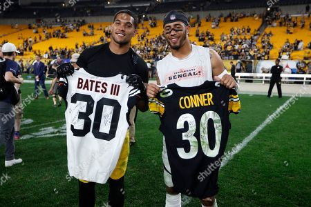 Pittsburgh Steelers running back James Conner, left, and Cincinnati Bengals free safety Jessie Bates swap jerseys following an NFL football game in Pittsburgh, . The Steelers won 27-3