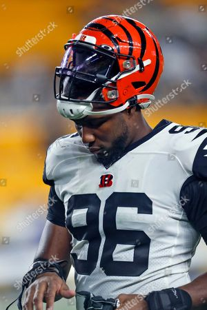 Stock Image of Cincinnati Bengals defensive end Carlos Dunlap (96) walks off the field following an NFL football game against the Pittsburgh Steelers in Pittsburgh