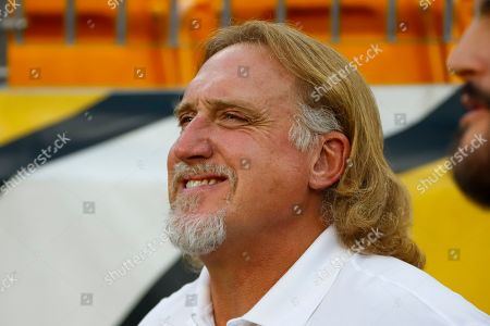Pro Football Hall of Fame outside linebacker Kevin Greene stands on the sidelines during warmups before an NFL football game between the Pittsburgh Steelers and the Cincinnati Bengals in Pittsburgh