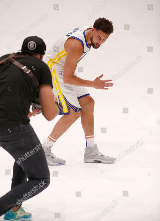 Golden State Warriors guard Klay Thompson (R) poses for Warriors team photographer Noah Graham (L) during the Golden State Warriors 2019-20 season Media Day at the Chase Center, the new home of the Golden State Warriors in San Francisco, California, USA, 30 September 2019.