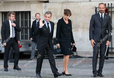 Stock Photo of Former French president Nicolas Sarkozy and wife Carla Bruni-Sarkozy greet Edouard Philippe
