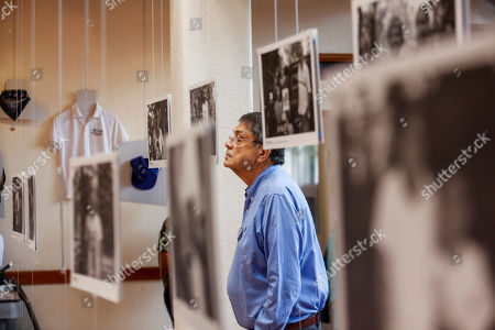 Writer Sergio Ramirez looks at a picture during the inauguration of an exhibit of photographs and personal items that belonged to people who have been killed over the last 1 ½ years amid anti-government protests in Managua, Nicaragua, . Hundreds of Nicaraguans have been killed or jailed and thousands have gone into exile since protests erupted in April 2018 demanding Ortega's resignation