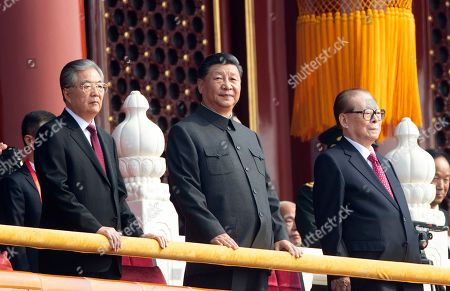 Chinese President Xi Jinping, center, with former presidents Jiang Zemin, right, and Hu Jintao, left, attend the celebration to commemorate the 70th anniversary of the founding of Communist China in Beijing