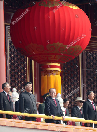 Chinese President Xi Jinping, second from left, with former presidents Jiang Zemin, center right, and Hu Jintao, left, attend the the celebration to commemorate the 70th anniversary of the founding of Communist China in Beijing