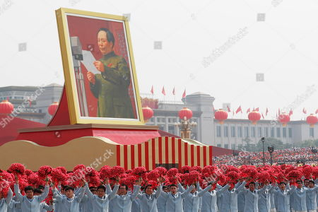 A float carrying a portrait of late Chinese leader and founder of the People's Republic of China, Mao Zedong Zedong, moves past Tiananmen Square during a military parade marking the 70th anniversary of the founding of the People's Republic of China, in Beijing, China, 01 October 2019. China commemorates the 70th anniversary of the founding of the People's Republic of China on 01 October 2019 with a grand military parade and mass pageant.