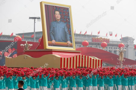 A float carrying a portrait of former Chinese President Hu Jintao moves past Tiananmen Square during a military parade marking the 70th anniversary of the founding of the People's Republic of China, in Beijing, China, 01 October 2019. China commemorates the 70th anniversary of the founding of the People's Republic of China on 01 October 2019 with a grand military parade and mass pageant.