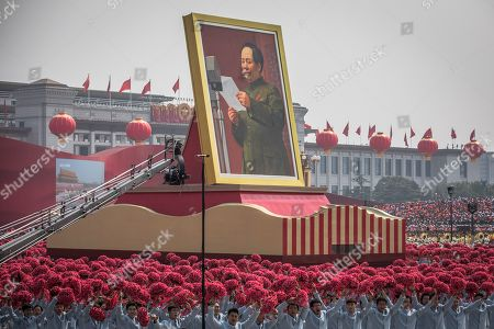 A float carrying a portrait of late Chinese leader and founder of the People's Republic of China, Mao Zedong Zedong, moves past Tiananmen Square, during a military parade marking the 70th anniversary of the founding of the People's Republic of China, in Beijing, China, 01 October 2019. China commemorates the 70th anniversary of the founding of the People's Republic of China on 01 October 2019 with a grand military parade and mass pageant.