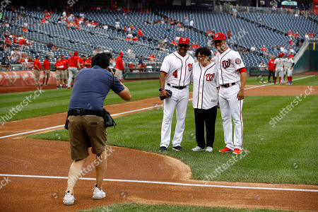 U.S. Supreme Court Associate Justice Sonia Sotomayor, center, poses for a photograph with Washington Nationals manager Dave Martinez, left, and left fielder Juan Soto after throwing out a ceremonial first pitch before a baseball game between the Nationals and the Philadelphia Phillies, in Washington