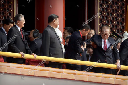 Stock Picture of Xi Jinping, Hu Jintao, Jiang Zemin. Chinese President Xi Jinping, center, and former president Hu Jintao, left, watch as former Chinese President Jiang Zemin is helped to his seat before a parade to commemorate the 70th anniversary of the founding of Communist China in Beijing, . Trucks carrying weapons including a nuclear-armed missile designed to evade U.S. defenses rumbled through Beijing as the Communist Party celebrated its 70th anniversary in power with a parade Tuesday that showcased China's ambition as a rising global force