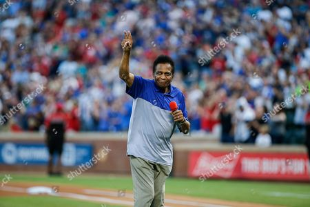 Country music singer Charley Pride sings the National Anthem before a baseball game between the New York Yankees and Texas Rangers, in Arlington, Texas. Texas won 9-4