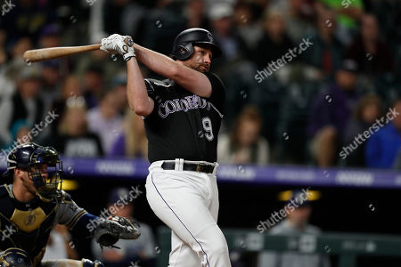 Stock Image of R m. Colorado Rockies first baseman Daniel Murphy (9) in the seventh inning of a baseball game, in Denver