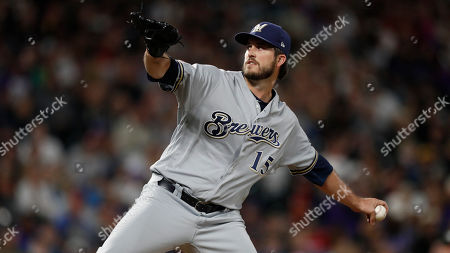 Milwaukee Brewers starting pitcher Drew Pomeranz (15) in the seventh inning of a baseball game, in Denver