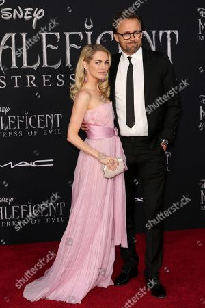 """Kristin Ronning, Joachim Ronning. Kristin Ronning, left, and Joachim Ronning arrive at the world premiere of """"Maleficent: Mistress of Evil"""", at the El Capitan Theatre in Los Angeles"""