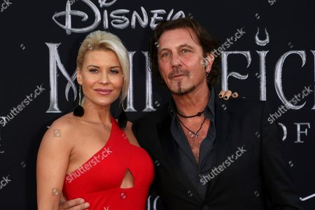 """McKenzie Westmore, Patrick Tatopoulos. McKenzie Westmore, left, and Patrick Tatopoulos arrive at the world premiere of """"Maleficent: Mistress of Evil"""", at the El Capitan Theatre in Los Angeles"""