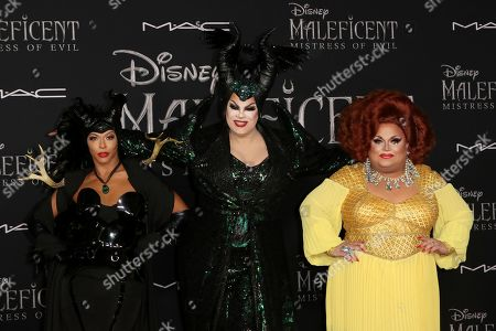 """Shangela, Nina West, Ginger Minj. Shangela, from left, Nina West and Ginger Minj arrive at the world premiere of """"Maleficent: Mistress of Evil"""", at the El Capitan Theatre in Los Angeles"""