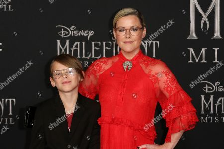 "William Robert Cowles, Kathleen Robertson. William Robert Cowles, left, and Kathleen Robertson arrive at the world premiere of ""Maleficent: Mistress of Evil"", at the El Capitan Theatre in Los Angeles"