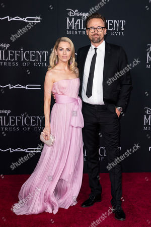 US fashion model Amanda Hearst (L) and her husband Norwegian film director Joachim Ronning (R) pose on the red carpet prior to the premiere of the film 'Maleficent: Mistress of Evil' at El Capitan Theater in Los Angeles, California, USA, 30 September 2019. The movie will be released in US theaters on 18 October.