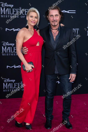 Greek-French production designer and director Patrick Tatopoulos and his wife US actress McKenzie Westmore pose on the red carpet prior to the premiere of Disney's 'Maleficent Mistress of Evil' at El Capitan Theater in Los Angeles, California, USA, 30 September 2019. The movie will be released in US theaters on 18 October.