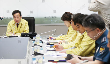 South Korean Prime Minister Lee Nak-yeon (L) chairs an anti-disaster meeting over an approaching typhoon and African swine fever alert, at the government complex in Seoul, South Korea, 01 October 2019. Typhoon Mitag is expected to make landfall on South Korea's southwest coast on 03 October 2019. The country has also confirmed nine cases of deadly swine fever since the first one on 17 September 2019.