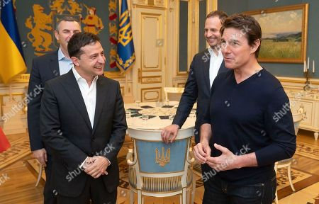 Stock Photo of Ukrainian President Volodymyr Zelensky and American actor, film director and producer Tom Cruise talk to each other during their meeting in Kyiv, Ukraine, late. At the invitation of President of Zelensky Tom Cruise arrived in Kyiv