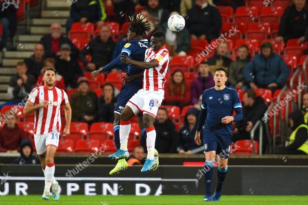 1st October 2019, Bet365 Stadium, Stoke-on-Trent, England; Sky Bet Championship, Stoke City v Huddersfield Town : Oghenekaro Etebo (8) of Stoke City and Trevoh Chalobah (8) of Huddersfield Town contest the high ball Credit: Richard Long/News Images