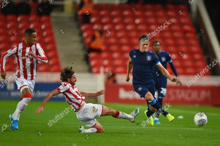1st October 2019, Bet365 Stadium, Stoke-on-Trent, England; Sky Bet Championship, Stoke City v Huddersfield Town : Joe Allen (4) of Stoke City clears the ball from Jonathan Hogg (6) of Huddersfield Town 