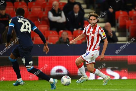 1st October 2019, Bet365 Stadium, Stoke-on-Trent, England; Sky Bet Championship, Stoke City v Huddersfield Town : Joe Allen (4) of Stoke City in action during the game ahead of Jaden Brown (28) of Huddersfield Town 