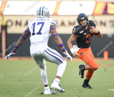 James Washington. Oklahoma State quarterback Spencer Sanders (3) looks back at Kansas State defensive back Jonathan Alexander (17), as he advances the ball during the first half of an NCAA college football game in Stillwater, Okla